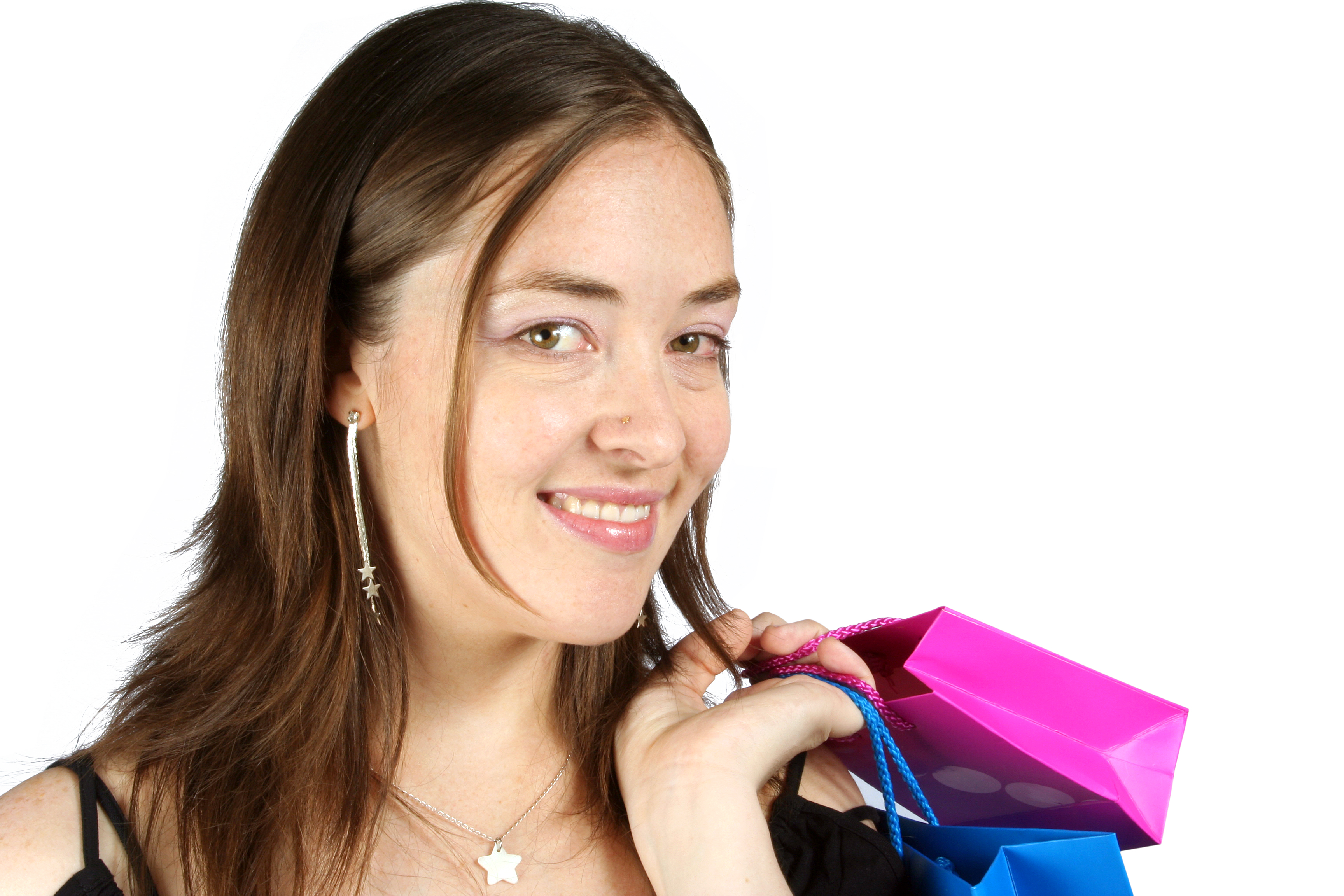 smiling business woman with shopping bags on her shoulder